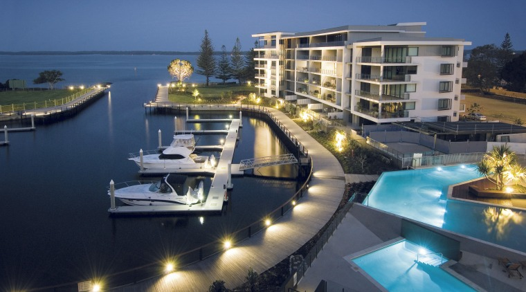 An exterior view of the New Stocland Allisse condominium, dock, hotel, luxury yacht, marina, mixed use, passenger ship, property, real estate, resort, yacht, blue