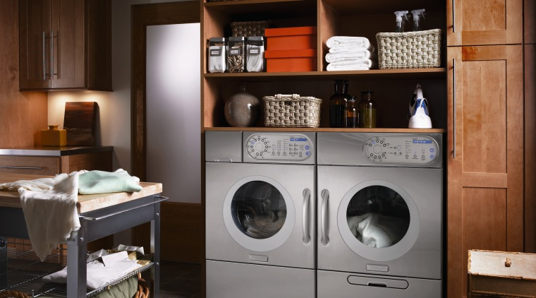 A view of this niche built in laundry cabinetry, clothes dryer, furniture, home appliance, laundry, laundry room, major appliance, room, washing machine, black, gray