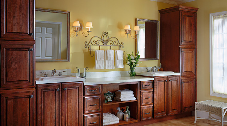 A view of these Luxury Bathrooms featuring stained cabinetry, chest of drawers, countertop, cuisine classique, floor, furniture, hardwood, home, interior design, kitchen, living room, room, wall, window, wood, wood stain, red, brown