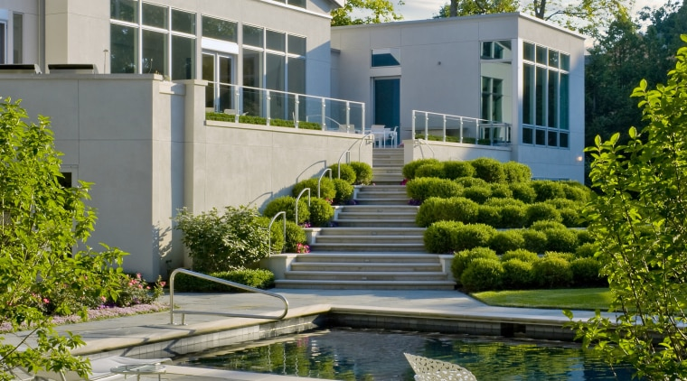 View of the house, white plaster walls, pool, architecture, condominium, corporate headquarters, daytime, estate, facade, headquarters, home, house, landscaping, mixed use, real estate, reflecting pool, reflection, residential area, tree, urban design, water, gray
