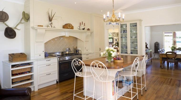 View of Kitchen designed by Delorenzo Design, Resene countertop, dining room, floor, flooring, hardwood, home, interior design, kitchen, living room, property, real estate, room, table, white