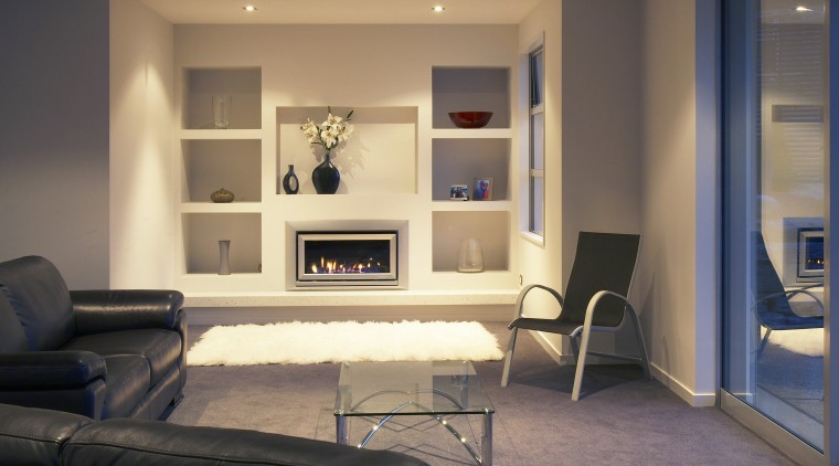A view of a fireplace from Escea. floor, flooring, furniture, home, interior design, living room, room, shelving, wall, orange