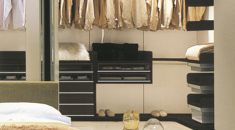 A view of a storage space designed by closet, furniture, interior design, wardrobe, gray
