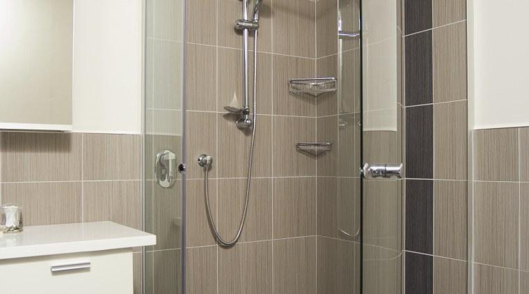 A view of some bathroomware from Kohler. angle, bathroom, floor, glass, plumbing fixture, shower, shower door, tile, gray