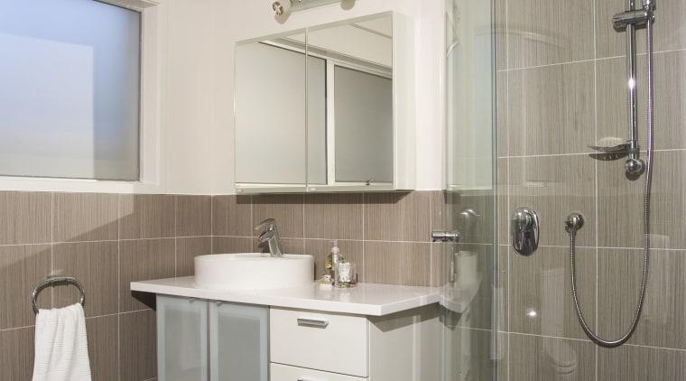 A view of some bathroomware from Kohler. bathroom, bathroom accessory, bathroom cabinet, floor, home, interior design, plumbing fixture, room, sink, gray