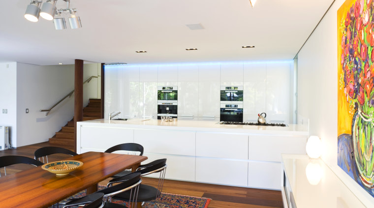 View of kitchen design by Linda Haefeli, and apartment, ceiling, home, interior design, kitchen, living room, real estate, room, table, white