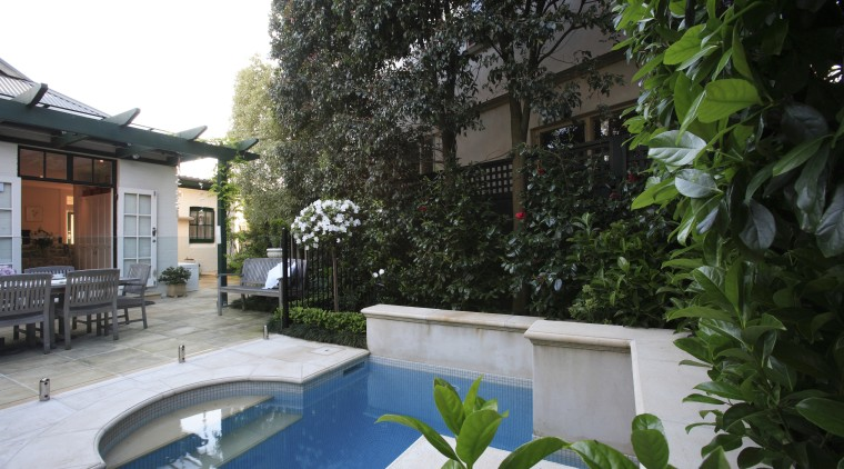 An exterior view of the pool and patio backyard, courtyard, estate, home, house, outdoor structure, plant, property, real estate, resort, tree, villa, yard, green