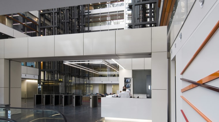 interior view of building featuring escalators, lighting, doors architecture, building, glass, institution, interior design, lobby, stairs, gray
