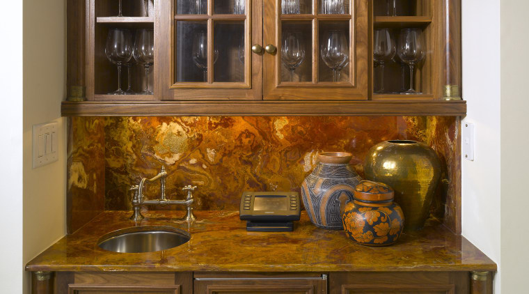 View of countertop by A Touch Of Stone. bookcase, cabinetry, chest of drawers, china cabinet, countertop, cuisine classique, cupboard, furniture, kitchen, kitchen organizer, shelf, shelving, wood stain, brown