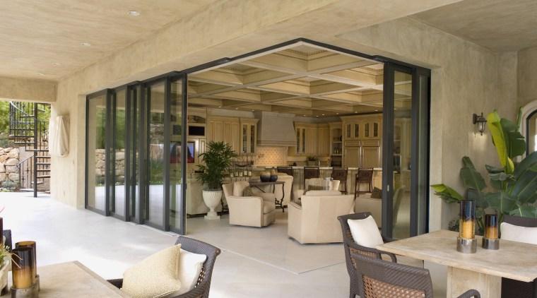 View of sliding doors by American View Windows. ceiling, estate, interior design, living room, real estate, brown, orange, gray