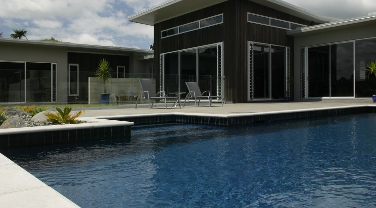 view of pool by Pool Resources. architecture, cloud, estate, home, house, property, real estate, reflection, sky, swimming pool, water, white