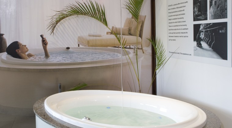 The Purist Whirlpool chromatherapy tub is paired with bathroom, bathtub, interior design, plumbing fixture, product design, gray
