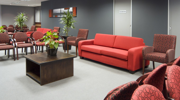 Vibrant red and gray furnishings  enliven the couch, furniture, interior design, living room, loveseat, room, table, waiting room, red, gray