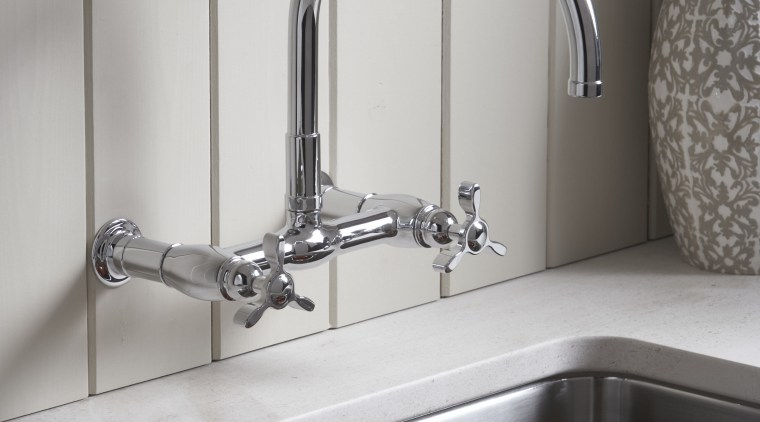 This kitchen features a wall-mounted Kohler Parq faucet. bathroom, kitchen, plumbing fixture, product design, sink, tap, gray