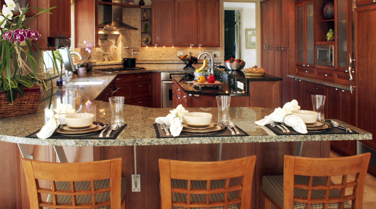 view of kitchen by Dream Kitchens, featuring cabinetry, countertop, interior design, kitchen, restaurant, room, red