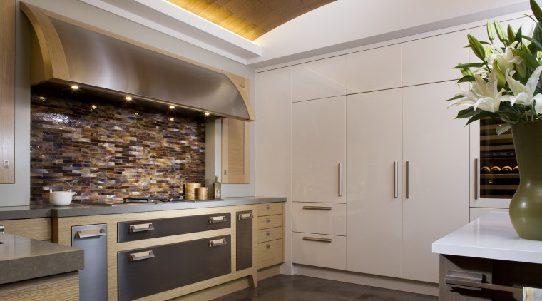 View of a kitchen designed and built by cabinetry, ceiling, countertop, cuisine classique, floor, flooring, interior design, kitchen, gray, brown
