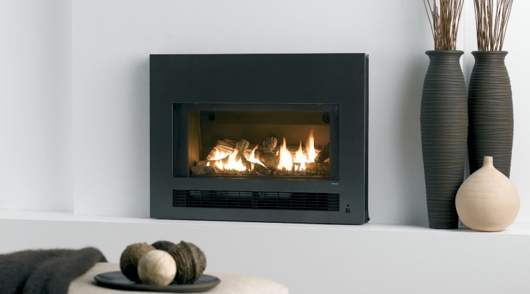 view of gas fireplaces by Rinnai. fireplace, hearth, heat, home appliance, wood burning stove, white