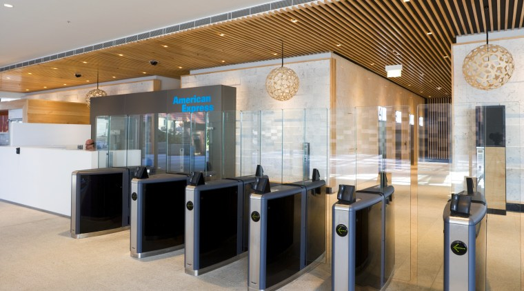 Security is tight, yet toughened-glass barriers lessen the interior design, lobby, gray