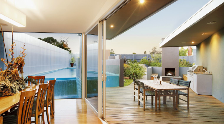 The house interlooks with a wedge-shaped pool, outdoor apartment, house, interior design, real estate, white