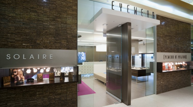 Image of Eyewear shop featuring cladding, cabinetry, tiled interior design, lobby, gray, brown