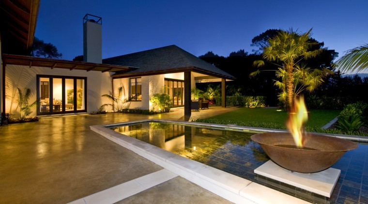 Exterior view of resort-style home which features Peter backyard, estate, hacienda, home, house, landscape lighting, lighting, property, real estate, residential area, resort, swimming pool, villa, brown, blue