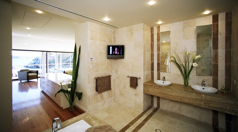 By opening up the bathroom and bedroom, and bathroom, estate, home, interior design, property, real estate, room, brown