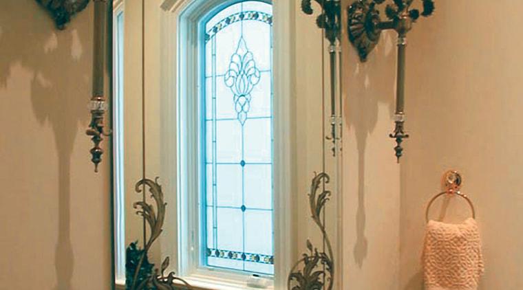 The beveled mirror in this bathroom has been bathroom, home, interior design, room, wall, window, brown, orange