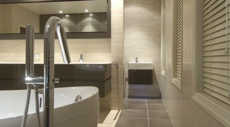 Image of a bathroom designed by NKBA and architecture, bathroom, daylighting, floor, flooring, interior design, room, sink, tile, brown, orange