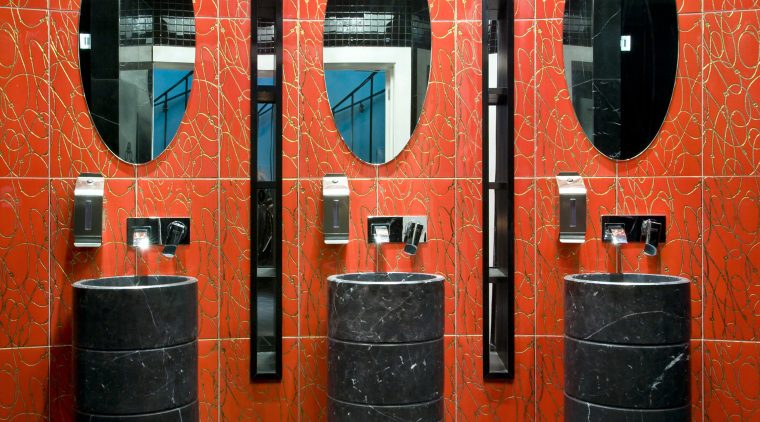 A decorative motif features throughout the interior. The interior design, orange, public toilet, red, room, wall, red