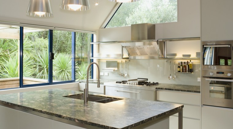 With a stainless steel frame and legs, and countertop, furniture, interior design, kitchen, product design, table, gray