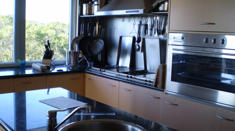 As the windows overlook a national park and countertop, cuisine classique, home appliance, kitchen, room, black