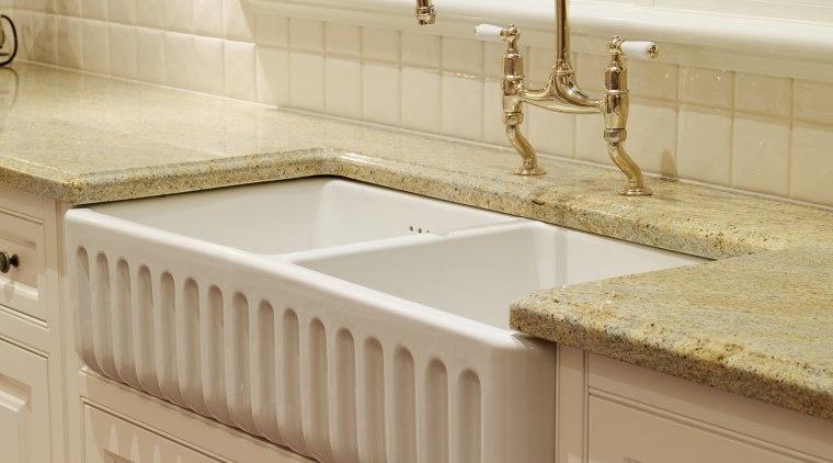 View of the double butler's sink which features bathroom, bathroom accessory, bathroom cabinet, bathroom sink, cabinetry, ceramic, countertop, floor, flooring, hardwood, kitchen, plumbing fixture, room, sink, tap, tile, wood stain, orange