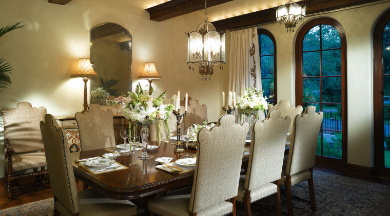 View of the dining room which features chandeliers, ceiling, dining room, function hall, home, interior design, restaurant, room, table, brown