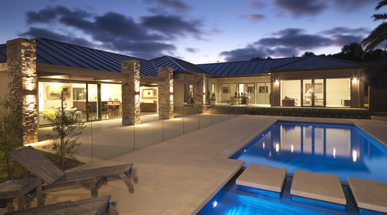 View of outdoor area, pool and spa which apartment, condominium, estate, home, hotel, house, landscape lighting, leisure, lighting, property, real estate, residential area, resort, resort town, sky, swimming pool, villa, blue, brown