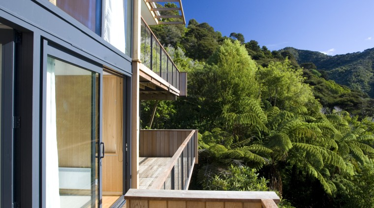 View of deck and side of house with apartment, architecture, balcony, cottage, daylighting, deck, estate, facade, home, house, property, real estate, residential area, roof, window