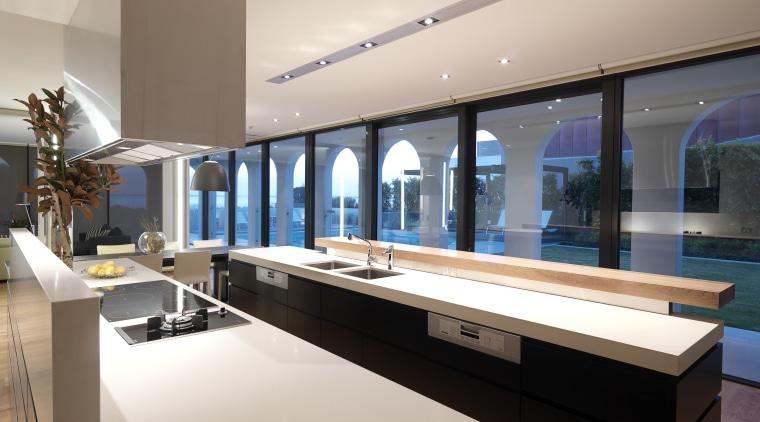 View of kitchen which features a kitchen island countertop, estate, interior design, gray
