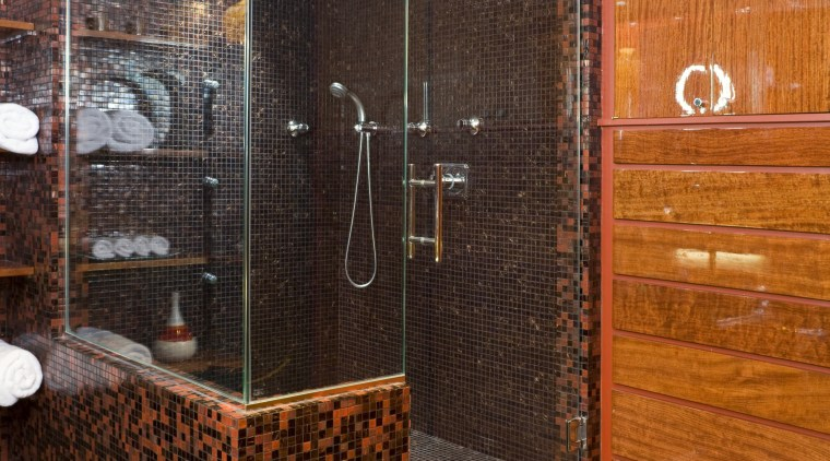 View of the master bathroom which features extensive bathroom, floor, flooring, interior design, room, tile, wall, brown