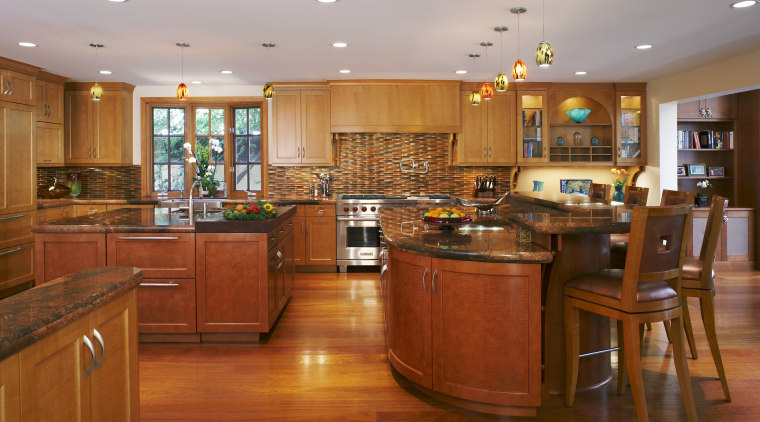 The kitchen is divided into a series of cabinetry, countertop, cuisine classique, flooring, hardwood, interior design, kitchen, real estate, room, wood, wood flooring, brown, gray