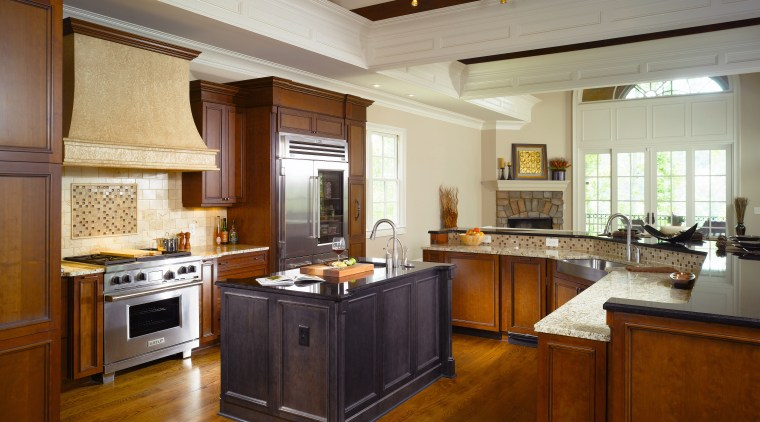 Different wood and granite types visually draw the cabinetry, ceiling, countertop, cuisine classique, estate, flooring, hardwood, interior design, kitchen, real estate, room, brown, gray