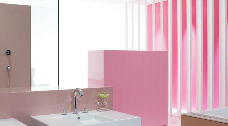 New Kohler bathroom fixtures include the Oblo faucet; bathroom, bathroom cabinet, floor, furniture, interior design, kitchen, pink, product, product design, purple, sink, table, white