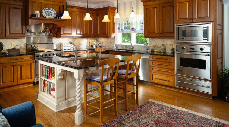 Image of a kitchen with a traditional design cabinetry, countertop, cuisine classique, floor, flooring, hardwood, home, interior design, kitchen, real estate, room, wood flooring, brown