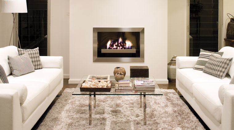 These Real Flame fireplaces, the Elegance and Pure couch, fireplace, floor, flooring, furniture, hearth, home, interior design, living room, room, table, white