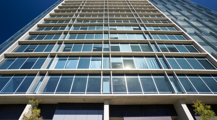 Image of the horizontal and vertical sun shading apartment, architecture, building, commercial building, condominium, corporate headquarters, daylighting, daytime, facade, headquarters, metropolis, metropolitan area, mixed use, real estate, residential area, sky, skyscraper, tower block, urban area, window