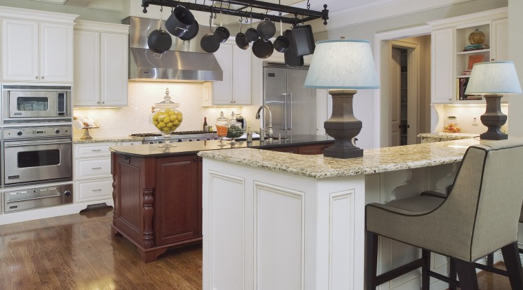 The placement of the stainless steel appliances in cabinetry, countertop, cuisine classique, floor, flooring, hardwood, home, home appliance, interior design, kitchen, room, gray