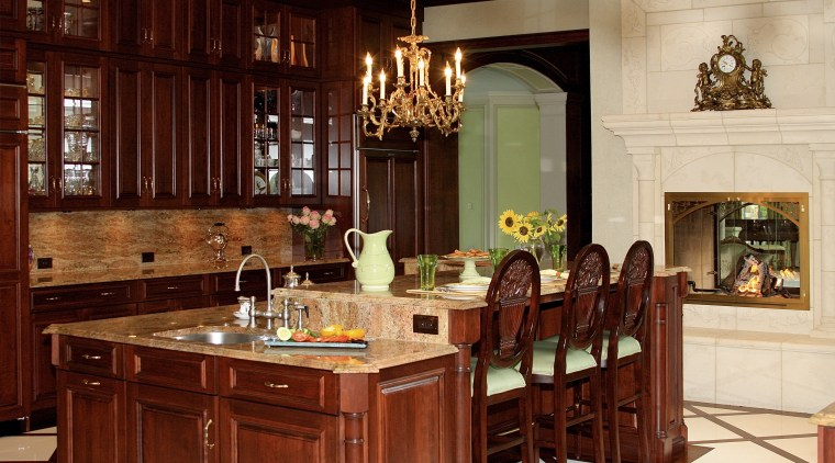 The handcrafted cherrywood cabinetry includes a multifunctional, furniture-styled cabinetry, countertop, cuisine classique, dining room, furniture, interior design, kitchen, room, red