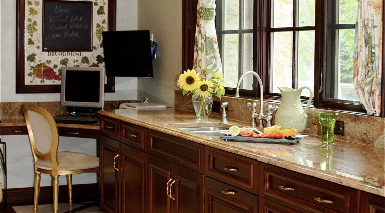 Rosewood granite countertops complement the paneled cherrywood doors cabinetry, countertop, flooring, furniture, home, interior design, kitchen, room, table, red, gray