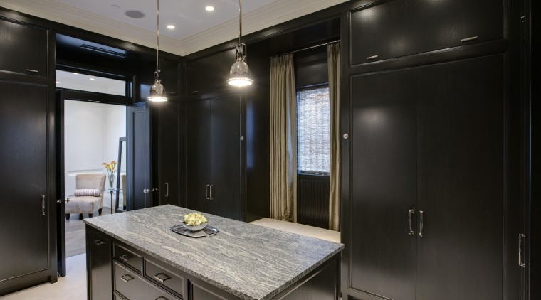 View of the dressing room featuring closets made cabinetry, countertop, interior design, kitchen, room, black, gray
