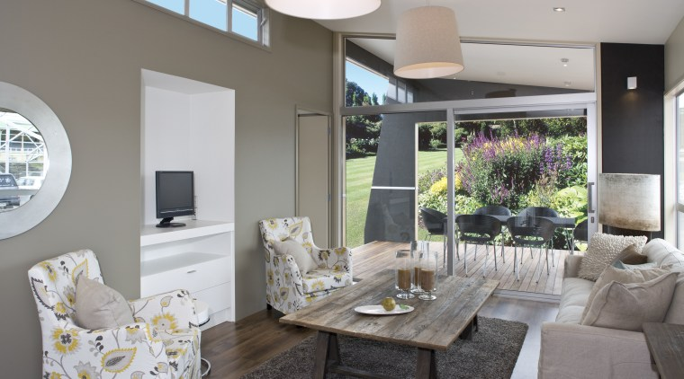 The outdoors is closely connected to the main dining room, home, interior design, living room, real estate, room, table, gray