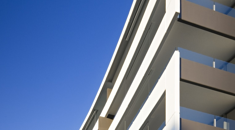 Exterior view of the Flow Apartments which sit apartment, architecture, building, commercial building, condominium, corporate headquarters, daylighting, daytime, facade, headquarters, line, metropolitan area, mixed use, sky, tower block, blue