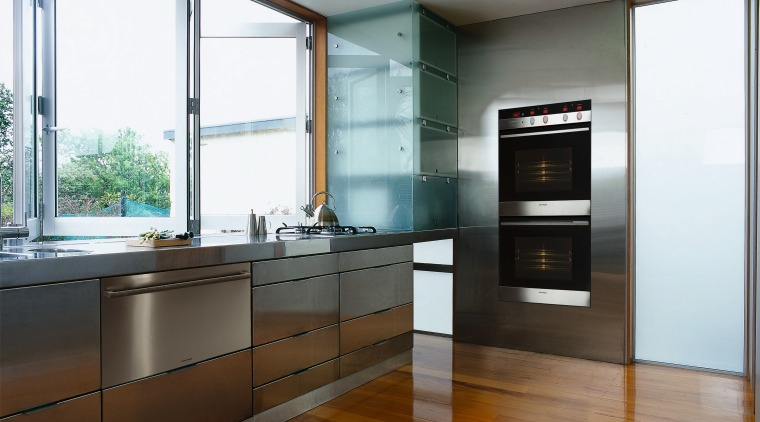 This Kitcehn showcases the new Fisher & Paykel cabinetry, countertop, floor, hardwood, interior design, kitchen, real estate, wood flooring, white, brown